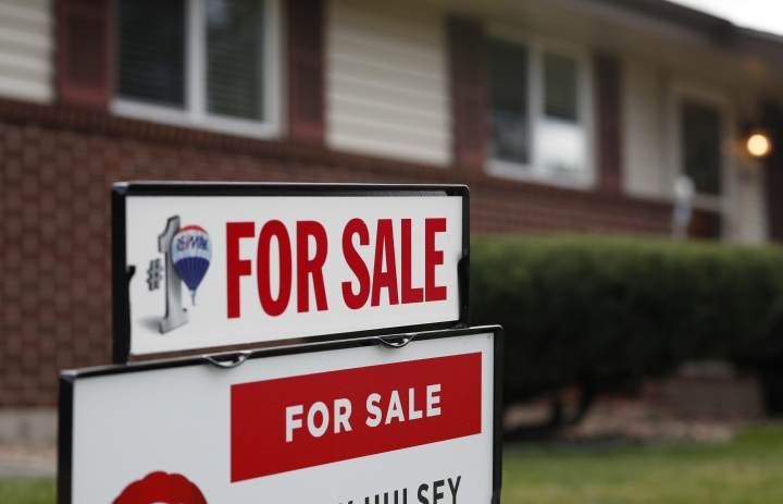 FILE- In this Oct 2, 2018, file photo a for sale sign stands outside a home on the market in the north Denver suburb of Thornton, Colo. Entry-level homes are hard to find. As a homebuyer, you can broaden your search by considering homes in need of improvement. (AP Photo/David Zalubowski, File)