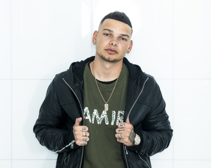 In this Nov. 7, 2018 photo, country singer Kane Brown poses for a portrait in New York. The singer from humble beginnings has become one of the brightest new singers in music and arguably country music's most successful act of the year. (Photo by Drew Gurian/Invision/AP)
