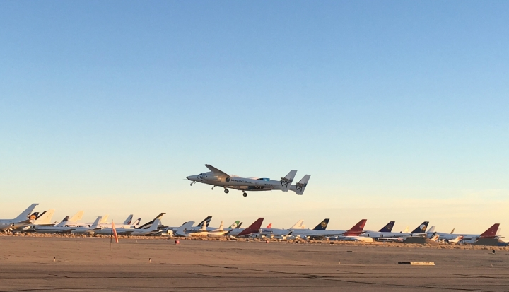 A jet carrying Virgin Galactic's tourism spaceship has taken off from Mojave Air and Space Port on Thursday, Dec. 13, 2018 in Mojave, Calif. The jet will climb to an altitude near 43,000 feet and then release Virgin Space Ship Unity. The pilots hope to fly the rocket ship to an altitude exceeding 50 miles (80 kilometers), which Virgin Galactic considers the boundary of space. (AP Photo/John Antczak)