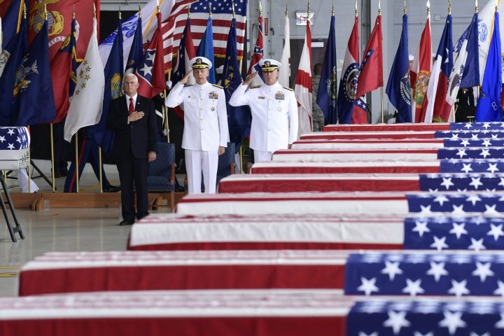 FILE - In this Aug. 1, 2018 file photo, Vice President Mike Pence, left, Commander of U.S. Indo-Pacific Command Adm. Phil Davidson, center, and Rear Adm. Jon Kreitz, deputy director of the POW/MIA Accounting Agency, attend at a ceremony marking the arrival of the remains believed to be of American service members who fell in the Korean War at Joint Base Pearl Harbor-Hickam, Hawaii, Wednesday, Aug. 1, 2018. North Korea handed over the remains. Pentagon officials say they have been unable so far to draw North Korea into negotiations on returning additional remains of Americans killed in North Korea. (AP Photo/Susan Walsh)