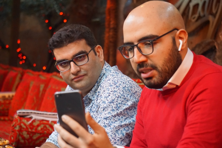Certfa researchers Nariman Gharib, right, and Amin Sabeti speak to a colleague at a cafe in London on Friday, Dec. 7, 2018. The Associated Press drew on data gathered by the London-based cybersecurity group Certfa to track how a hacking group often nicknamed Charming Kitten spent the past month trying to break into the private emails of more than a dozen U.S. Treasury officials. Also on the hackers' hit list: high-profile defenders, detractors and enforcers of the nuclear deal struck between Washington and Tehran, as well as Arab atomic scientists, Iranian civil society figures and D.C. think tank employees. (AP Photo/Raphael Satter)