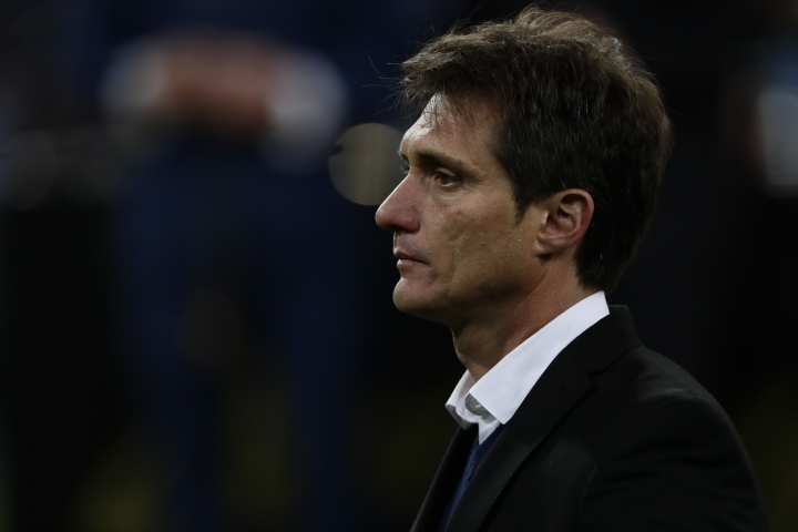 Guillermo Barros Schelotto, coach of Argentina's Boca Juniors, stands in the pitch after his team's 1-3 lost against Argentina's River Plate in the Copa Libertadores final soccer match at the Santiago Bernabeu stadium in Madrid, Spain, Sunday, Dec. 9, 2018. (AP Photo/Manu Fernandez)