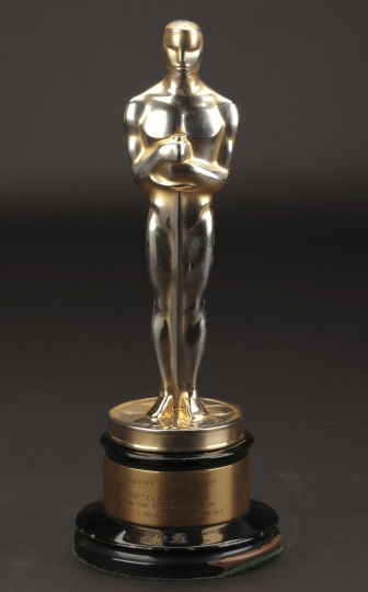 """FILE - This undated file image provided by Profiles in History shows the best picture Academy Award for """"Gentleman's Agreement."""" The best-picture Oscar for """"Gentleman's Agreement,"""" the 1947 film starring Gregory Peck that took on anti-Semitism, sold for $492,000, in a rare auction of Oscars that ended Friday, Dec. 14, 2018, in Los Angeles. (Lou Bustamante/Profiles in History via AP, File)"""