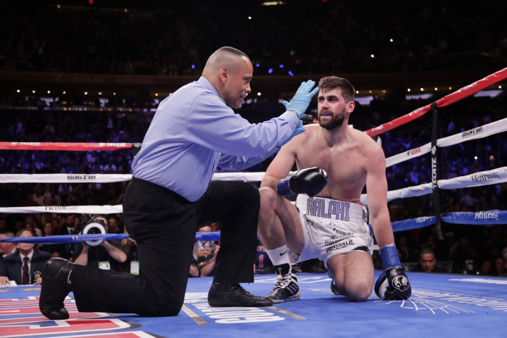 The referee counts for England's Rocky Fielding after he was knocked down during the first round of a WBA super middleweight championship boxing match against Mexico's Canelo Alvarez Saturday, Dec. 15, 2018, in New York. Alvarez stopped Fielding in the third round. (AP Photo/Frank Franklin II)