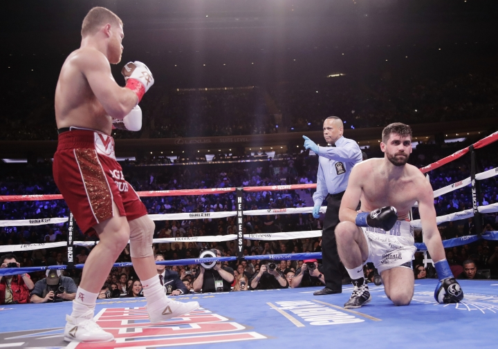 England's Rocky Fielding takes a knee after being knocked down by Mexico's Canelo Alvarez, left, during the first round of a WBA super middleweight championship boxing match Saturday, Dec. 15, 2018, in New York. Alvarez stopped Fielding in the third round. (AP Photo/Frank Franklin II)