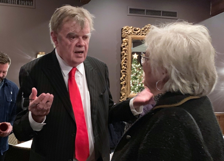 "In this Sunday, Dec. 16, 2018, former ""A Prairie Home Companion"" host Garrison Keillor talks to fans after his performances at Crooners lounge in Fridley, Minn. Keillor is stepping back into the spotlight a year after Minnesota Public Radio cut ties with him over a sexual misconduct allegation. Keillor performed two sold-out shows Sunday night at Crooners, a jazz nightclub in a Minneapolis suburb near where he grew up. Fans laughed, applauded and sang along. (AP Photo/Jeff Baenen)"