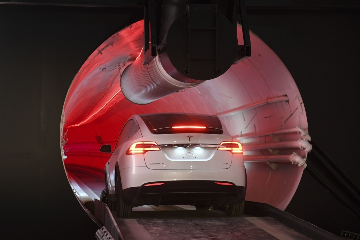 """A modified Tesla Model X drives in the tunnel entrance before an unveiling event for the Boring Co. Hawthorne test tunnel in Hawthorne, Calif., Tuesday, Dec. 18, 2018. Elon Musk unveiled his underground transportation tunnel on Tuesday, allowing reporters and invited guests to take some of the first rides in the revolutionary albeit bumpy subterranean tube - the tech entrepreneur's answer to what he calls """"soul-destroying traffic."""" (Robyn Beck/Pool Photo via AP)"""