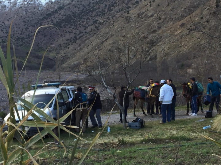In this photo provided by Moroccan news channel 2M and taken on Tuesday, Dec. 18, 2018, a security team is seen at the area where the bodies of two Scandinavian women tourists were found dead, near Imlil in the High Atlas mountains, Morocco. The lone suspect arrested in the killing of two female Scandinavian tourists is connected to a terrorist group, and three other suspects are on the run, Moroccan prosecutors said Wednesday. (2M via AP)
