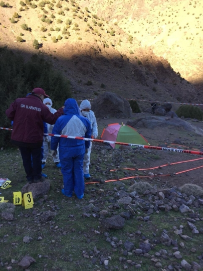 In this photo provided by Moroccan news channel 2M and taken on Tuesday, Dec. 18, 2018, a forensic team is seen at the area where the bodies of two Scandinavian women tourists were found dead, near Imlil in the High Atlas mountains, Morocco. The lone suspect arrested in the killing of two female Scandinavian tourists is connected to a terrorist group, and three other suspects are on the run, Moroccan prosecutors said Wednesday. (2M via AP)