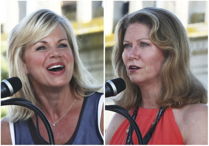 "In this combination of Aug. 30, 2018, file photos, Gretchen Carlson, left, chairwoman of the Miss America board of directors, and Regina Hopper, the pageant's CEO speaks to the contestants and the crowd during the annual Miss America arrival celebration in Atlantic City, N.J. Carlson, Hopper and the Miss America Organization are being sued by a former board member and four states claiming ""an illegal and bad-faith takeover"" of the pageant. The lawsuit filed Wednesday, Dec. 19, 2018, in Atlantic City. (Erin Grugan/The Press of Atlantic City via AP)"