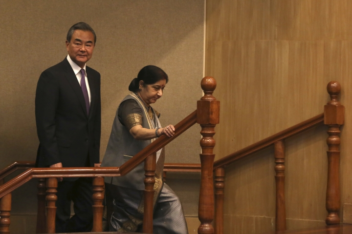 Indian Foreign Minister Sushma Swaraj, right, and her Chinese counterpart Wang Yi walk to attend the inaugural session of the India- China High Level Media Forum in New Delhi, India, Friday, Dec. 21, 2018. Swaraj and Wang took up enhancing cooperation in tourism, art, film, media, culture, yoga, sports, academic and youth exchanges, according to a tweet from India's External Affairs Ministry spokesman Raveesh Kumar. (AP Photo)
