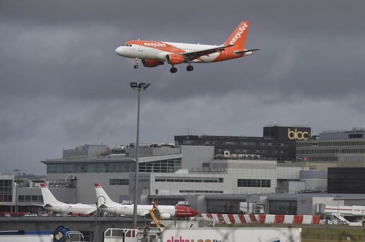 An EasyJet plane on its final approach before landing at Gatwick airport near London, Friday Dec. 21, 2018. Flights resumed at London's Gatwick Airport on Friday morning after drones sparked the shutdown of the airfield for more than 24 hours, leaving tens of thousands of passengers stranded or delayed during the busy holiday season. (John Stillwell/PA via AP)