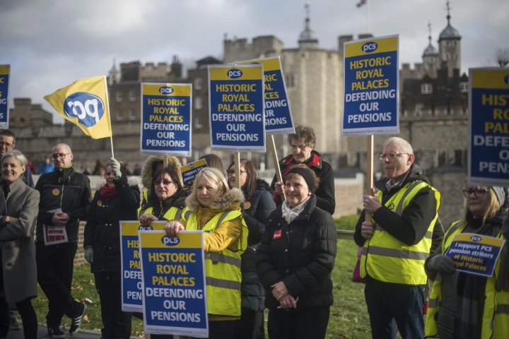 People at the Tower of London on the picket line as staff from Royal Palaces take industrial action over pay. Friday, Dec. 21, 2018. The strikers carried placards but did not close the popular tourist attraction. There were also strikers outside Hampton Court Palace and Kensington Palace, which both remained open. It was the first Beefeaters job action since the 1960s. (Pete Summers/PA via AP)