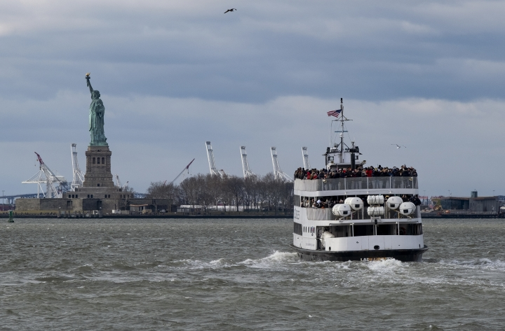 A ferry full of passengers steams towards the Statue of Liberty Saturday, Dec. 22, 2018, in New York. The national landmark remained open despite a partial government shutdown after New York Governor Andrew Cuomo made funding available to keep the monument open. (AP Photo/Craig Ruttle)