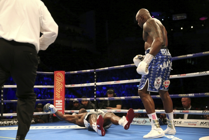 Dereck Chisora, left, is knocked out by Dillian Whyte during a heavyweight boxing bout Saturday, Dec. 22, 2018, in London. (Steven Paston/PA via AP)