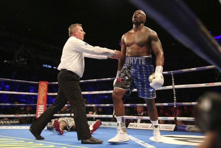 Dillian Whyte celebrates after knocking out Dereck Chisora during a heavyweight boxing bout Saturday, Dec. 22, 2018, in London. (Steven Paston/PA via AP)(/PA via AP)