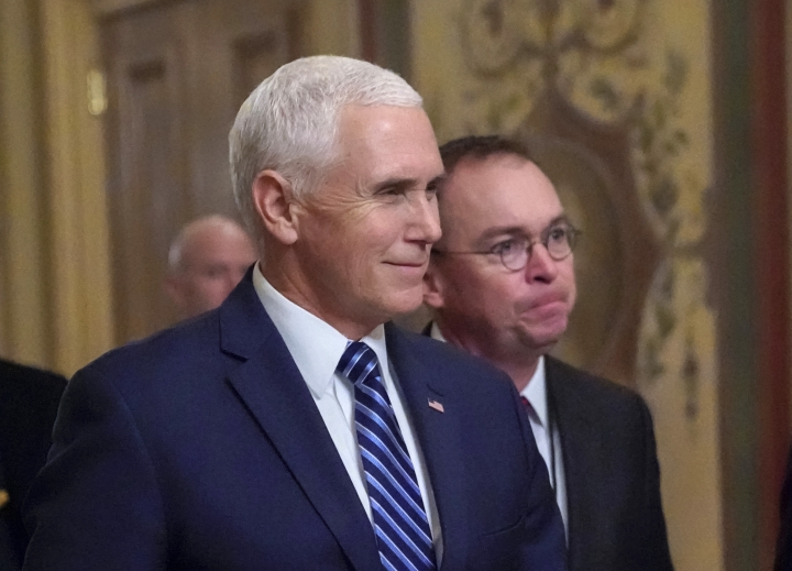 Vice President Mike Pence, left, walks with acting-White House Chief of Staff Mick Mulvaney, as they arrive at the Capitol as Congress resumes talks on funding without a compromise over money for President Donald Trump's promised wall along the U.S.-Mexico border, in Washington, Saturday, Dec. 22, 2018. (AP Photo/J. Scott Applewhite)