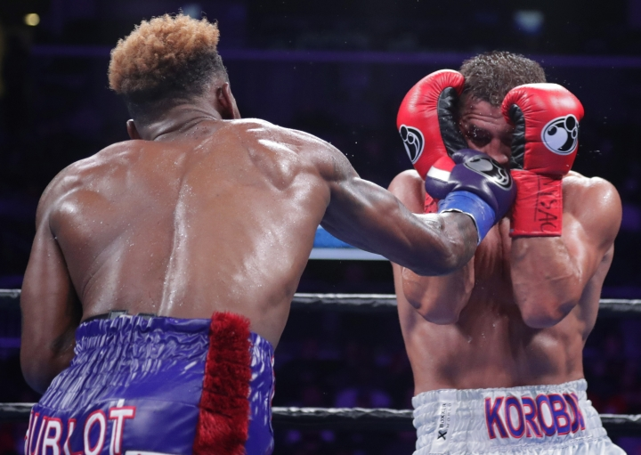 Jermall Charlo, left, punches Russia's Matt Korobov during the sixth round of a WBC middleweight boxing match Saturday, Dec. 22, 2018, in New York. Charlo won the fight. (AP Photo/Frank Franklin II)