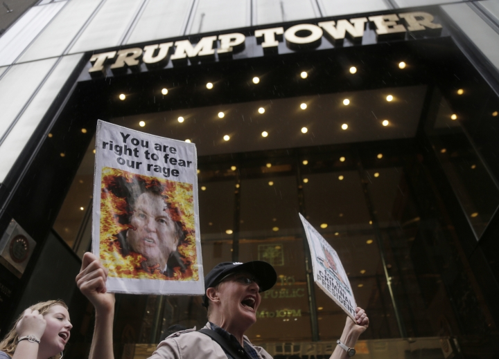 "FILE- In this Oct. 4, 2018 file photo, protesters rally in front of Trump Tower in New York. Many believed that the presidency would be a boon to Donald Trump's business, but signs are emerging that it has hurt it instead. ""He can be very polarizing ... the brand has been diminished,"" said Jeff Lotman, CEO of licensing firm Global Icons. New York brand consultant Robert Passikoff put it more bluntly: ""The Trump brand has lost its mojo."" (AP Photo/Seth Wenig, File)"