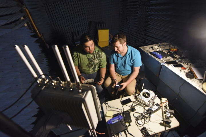 In this September 2018 photo provided by the Idaho National Laboratory, INL interns Armando Juarez Jr., left, and Jordan Mussman work in the Faraday room in a cybersecurity electronics lab in Idaho Falls, Idaho. The Idaho National Laboratory next year will move into a massive cybersecurity building and another that will house one of the nation's most powerful supercomputers. (Chris Morgan/Idaho National Laboratory via AP)