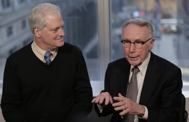 In this Dec. 19, 2018 photo, Craig Antico, left, and Jerry Ashton, co-founders of RIP Medical Debt, talks to reporters in New York. The co-founders of RIP Medical Debt buy millions of dollars in past-due medical debt for pennies on the dollar. But instead of hounding people to pay, they send letters saying the debt is erased, no strings attached. (AP Photo/Seth Wenig)