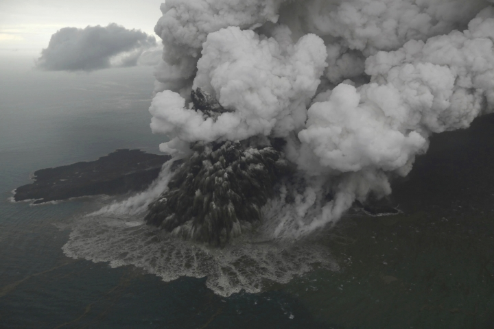 This aerial shot taken on Sunday, Dec. 23, 2018 shows Mount Anak Krakatau as it erupts on Java Strait, Indonesia. Doctors worked to save injured victims while hundreds of military and volunteers scoured debris-strewn beaches in search of survivors Monday, Dec. 24, 2018, after a deadly tsunami that followed an eruption and apparent landslide on the volcano, one of the world's most infamous volcanic islands, gushed ashore without warning on Indonesian islands on a busy holiday weekend. (Nurul Hidayat/Bisnis Indonesia via AP)