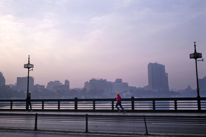 In this Jan. 22, 2017 file photo, a man jogs on Kasr El Nil bridge as the sun begins to rise, in Cairo, Egypt. In televised comments in December 2018, the general-turned-president railed about the number of overweight people he sees and told Egyptians they must take better care of themselves. He said physical education should become core curriculum at schools and universities and suggested TV shows shouldn't let presenters or guests on the air if they are overweight. (AP Photo/Nariman El-Mofty, File)