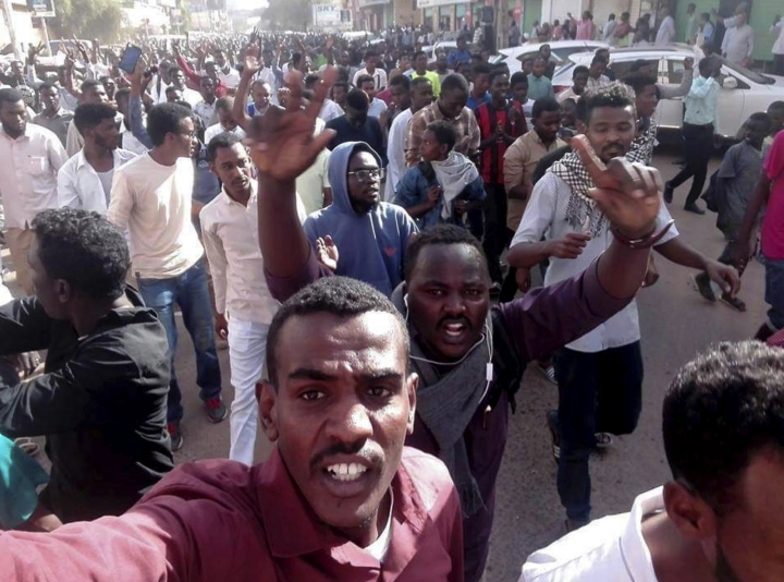 In this Thursday, Dec. 20, 2018 handout photo provided by a Sudanese activist, protesters chant slogans during a demonstration, in Khartoum, Sudan. The protest was one in a series of anti-government protests across Sudan, initially sparked by rising prices and shortages. (Sudanese Activist via AP)
