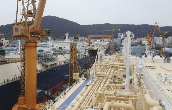 In this Friday, Dec. 7, 2018 photo, liquefied natural gas (LNG) carriers are being constructed at the Daewoo Shipbuilding and Marine Engineering facility in Geoje Island, South Korea. More than half of the 35 vessels scheduled for delivery in 2018 were LNG carriers. A similar number of vessels are lined up for completion in 2019. (AP Photo/Ahn Young-joon)