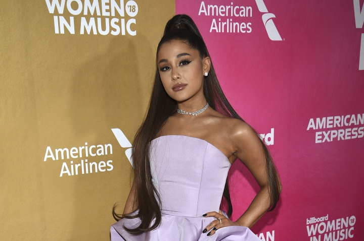 "FILE - In a Thursday, Dec. 6, 2018 file photo, Ariana Grande attends the 13th annual Billboard Women in Music event at Pier 36, in New York. Ariana Grande has cancelled a Las Vegas performance scheduled for Saturday, Dec. 29, 2018 ""due to unforeseeable health reasons.""(Photo by Evan Agostini/Invision/AP, File)"