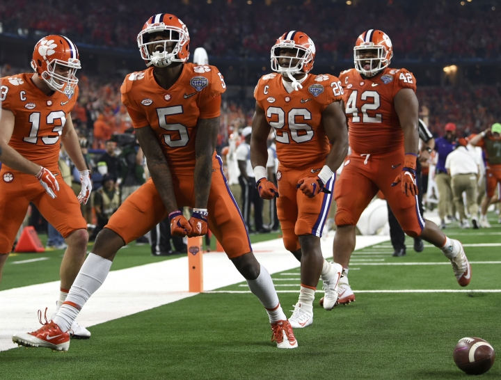 Clemson wide receiver Tee Higgins (5) celebrates his touchdown catch with wide receiver Hunter Renfrow (13), running back Adam Choice (26) and linebacker John Boyd (46) in the first half of the NCAA Cotton Bowl semi-final playoff football game against Notre Dame on Saturday, Dec. 29, 2018, in Arlington, Texas. (AP Photo/Jeffrey McWhorter)