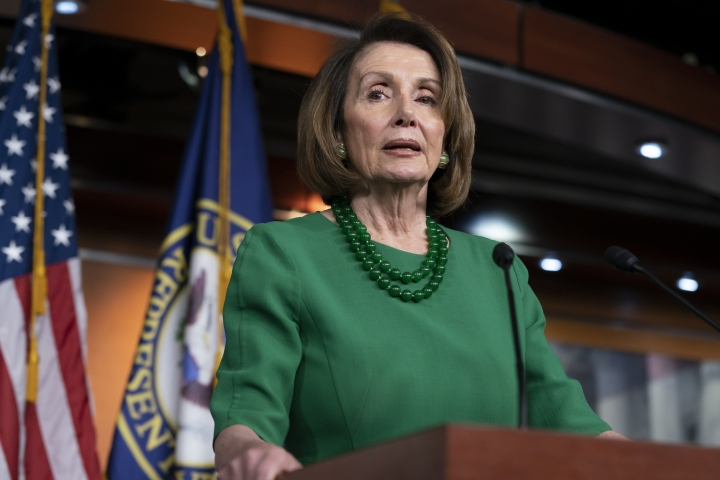 FILE - In this Thursday, Dec. 20, 2018 file photo, House Democratic Leader Nancy Pelosi of California, talks to reporters as Congress tries to pass legislation that would avert a partial government shutdown, at the Capitol in Washington. Pelosi and President Donald Trump both think they have public sentiment on their side in the battle over a border wall. That theory will be put the test this week when the new House Democratic majority led by Pelosi gavels into session with legislation to end the government shutdown. (AP Photo/J. Scott Applewhite, File)