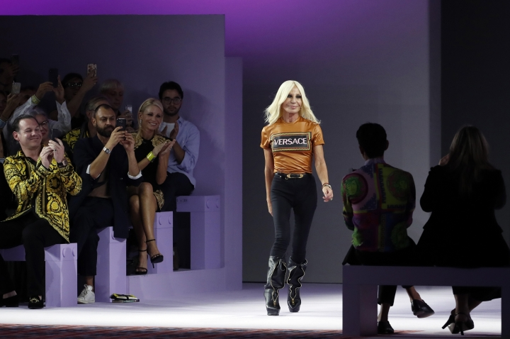 FILE - In this Friday, Sept. 21, 2018 file photo, Donatella Versace comes on the catwalk at the end of Versace's women's 2019 Spring-Summer collection, unveiled during the Fashion Week in Milan, Italy. Luxury fashion company Michael Kors Holdings is now Capri Holdings Limited after completing its acquisition of Versace. Michael Kors Holdings Ltd. announced the purchase of the Italian fashion house Versace for more than $2 billion (1.83 billion euros) in September.. (AP Photo/Antonio Calanni, File)