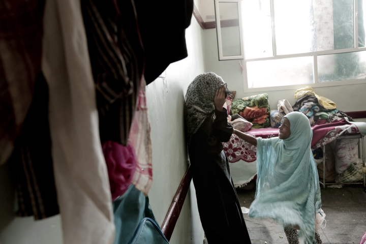 Sisters play in their room at a shelter for displaced persons in Ibb, Yemen in this Aug. 3, 2018, photo. An AP investigation found that large amounts of international food aid is making into the country, but once there, the food often isn't getting to people who need it most. Factions on all sides of the conflict have kept food from communities not in their favor, diverted it to front-line combat units or sold it for profit on the black market. (AP Photo/Nariman El-Mofty)