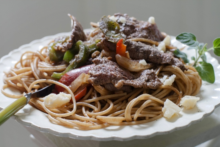 FILE - This June 9, 2014 file photo shows a dish of steak and cheese pasta in Concord, N.H. Two major studies in 2018 provided more fuel for the debate around carbs and fats, yet failed to offer a resolution to the polarizing matter of the best way to lose weight. (AP Photo/Matthew Mead)