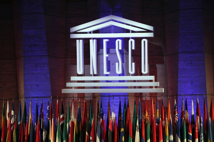 FILE - In this Saturday, Nov. 4, 2017 file photo, the logo of the United Nations Educational, Scientific and Cultural Organisation (UNESCO) is seen during the 39th session of the General Conference at the UNESCO headquarters in Paris, France. The United States and Israel have quit the U.N.'s educational, scientific and cultural agency, arguing the organization fosters anti-Israel bias. (AP Photo/Christophe Ena, File)
