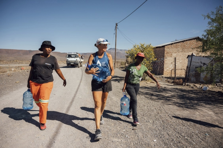 In this Monday, Dec. 31, 2018 photo supplied by Flux Communications, Mina Guli, an Australian activist seeking to highlight global water shortages, walks through drought-stricken Beaufort West, in South Africa. Guli is struggling to complete 100 marathons in 100 days across the world. Now in South Africa, 48-year-old Guli is more than half-way through the punishing project, but she's injured and a spokeswoman said Wednesday, Jan. 2, 2019 that the advocate will walk the rest of the marathons. (Kelvin Trautman, Flux Communications via AP)