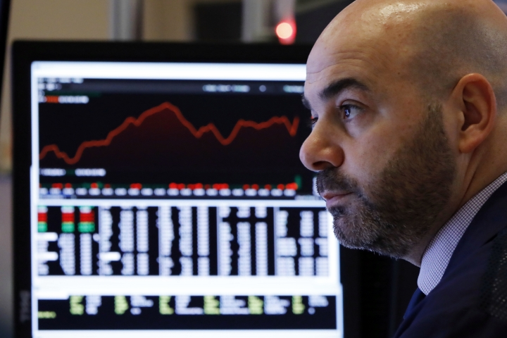 Trader Fred DeMarco works in a booth on the floor of the New York Stock Exchange, Wednesday, Jan. 2, 2019. Stock markets started the new year with a tumble, as disappointing Chinese economic data on Wednesday renewed concerns that a global trade war is weighing on growth. (AP Photo/Richard Drew)