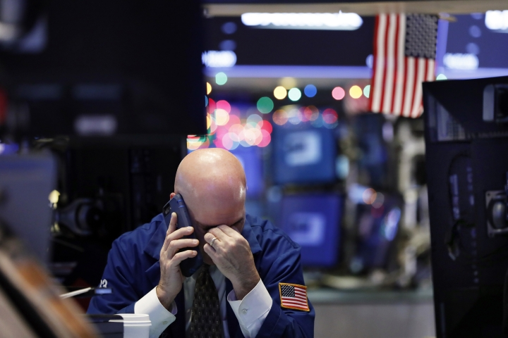 A trader talks on his phone on the floor of the New York Stock Exchange, Wednesday, Jan. 2, 2019. Stock markets started the new year with a tumble, as disappointing Chinese economic data on Wednesday renewed concerns that a global trade war is weighing on growth. (AP Photo/Richard Drew)
