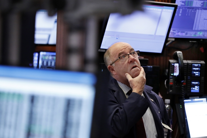 Trader Frederick Reimer works on the floor of the New York Stock Exchange, Wednesday, Jan. 2, 2019. Stock markets started the new year with a tumble, as disappointing Chinese economic data on Wednesday renewed concerns that a global trade war is weighing on growth. (AP Photo/Richard Drew)