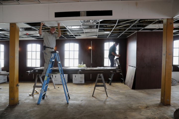 "In this Nov. 29, 2018, photo, workers install a ceiling during the restoration of the ""City of New Orleans"" riverboat in New Orleans. For years the City of New Orleans operated as a casino boat in Rock Island, Ill., until the mid-1990s. But after that state legalized onshore casinos, the boat became obsolete, said Matthew Dow, project manager heading the vessel's renovation. The then-named ""Casino Rock Island"" sat unused for years until it was purchased by the New Orleans Steamboat Company in 2016. (AP Photo/Gerald Herbert)"
