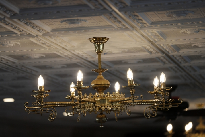 "This Nov. 29, 2018, photo shows a chandelier inside the ""City of New Orleans"" riverboat, as it is being restored in New Orleans. For years the City of New Orleans operated as a casino boat in Rock Island, Ill., until the mid-1990s. But after that state legalized onshore casinos, the boat became obsolete, said Matthew Dow, project manager heading the vessel's renovation. The then-named ""Casino Rock Island"" sat unused for years until it was purchased by the New Orleans Steamboat Company in 2016. (AP Photo/Gerald Herbert)"
