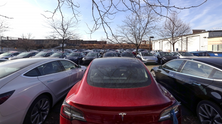 This Dec. 18, 2018, photo shows a lot full of Tesla vehicles in Chicago. Tesla made about 9,300 more vehicles than it delivered in 2018, raising concerns among industry analysts that inventory is growing as demand for the company's electric cars may be starting to wane. (AP Photo/Teresa Crawford)