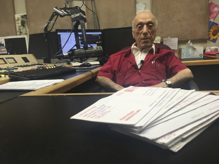 In this Oct. 9, 2018 photo, DJ Art Laboe sits in his Palm Springs, Calif., studio and talks about his 75 years in the radio business. Laboe remains a popular DJ among generations of Mexican American in California, Arizona and New Mexico and has a devoted following among those who every Sunday on his syndicated radio show give dedications to loved ones serving time in prison. (AP Photo/Russell Contreras)