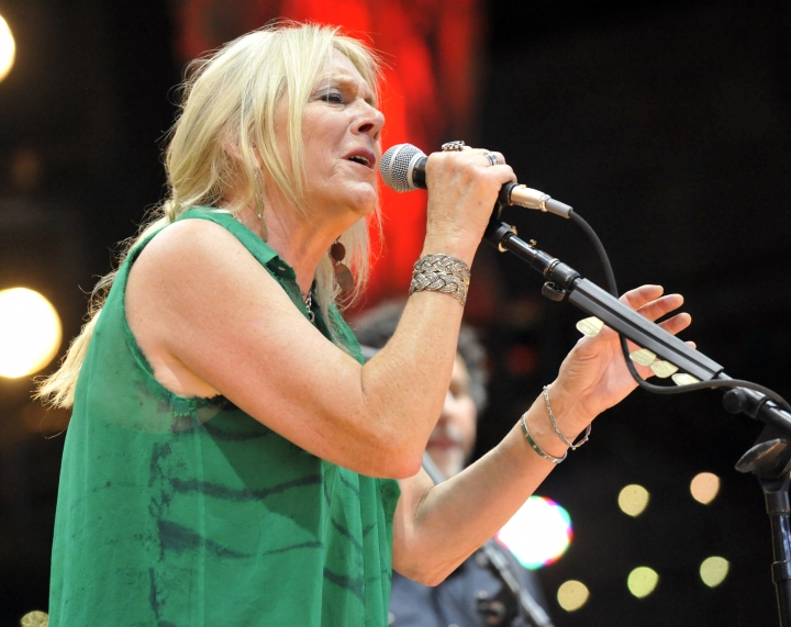 FILE - In this Sept. 21, 2013 file photo, Pegi Young & The Survivors perform with Neil Young during the Farm Aid 2013 concert at Saratoga Performing Arts Center in Saratoga Springs, N.Y. Young, who with fellow musician and then-husband Neil Young helped found the Bridge School for children with speech and physical impairments, has died. Young died of cancer Tuesday, Jan. 1, 2019, in California, according to spokeswoman Michelle Gutenstein-Hinz. She was 66. (AP Photo/Hans Pennink, File)