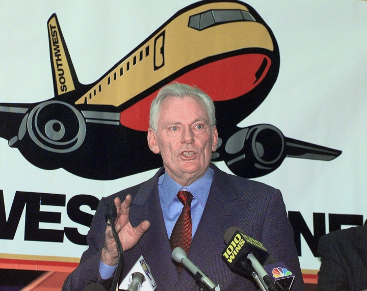 FILE - In this Dec. 9, 1998, file photo, Southwest Airlines President and CEO Herb Kelleher speaks at a news conference at MacArthur Airport in Islip, N.Y. Not many CEOs dress up as Elvis Presley, settle a business dispute with an arm-wrestling contest, or go on TV wearing a paper bag over their head. Southwest confirmed Kelleher died on Thursday, Jan. 3, 2019. He was 87. (AP Photo/Ed Betz, File)