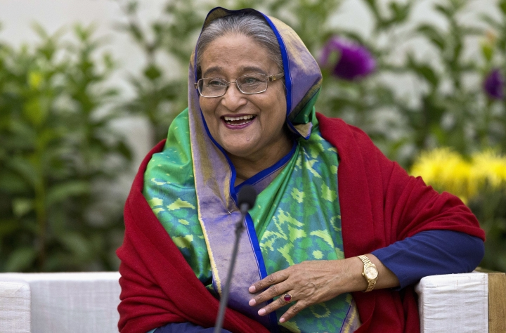 FILE - In this Monday, Dec. 31, 2018, file photo, Bangladeshi Prime Minister Sheikh Hasina interacts with journalists in Dhaka, Bangladesh. Hasina is set to begin a third straight term as Bangladesh's prime minister after a landslide election victory, but critics fear her coalition's dominance in Parliament leaves space for her to be more authoritarian. (AP Photo/Anupam Nath, File)