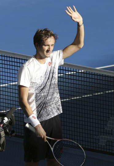 Daniil Medvedev of Russia waves at the crowd after he won his quarter final match against Milos Raonic of Canada at the Brisbane International tennis tournament in Brisbane, Australia, Friday, Jan. 4, 2019. (AP Photo/Tertius Pickard)