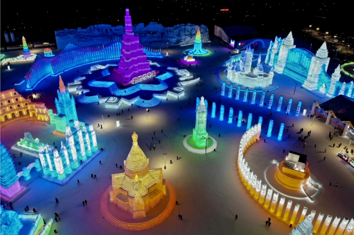 An aerial view taken with a drone shows visitors tour colorful structure made from blocks of ice at the Harbin International Ice and Snow festival held in Harbin in northeastern's China's Heilongjiang province, Friday, Jan. 4, 2019. The Harbin International Ice and Snow Festival is known for massive, elaborate and colorfully lit ice sculptures featuring animals, cartoon characters and famous landmarks. (AP Photo/Olivia Zhang)