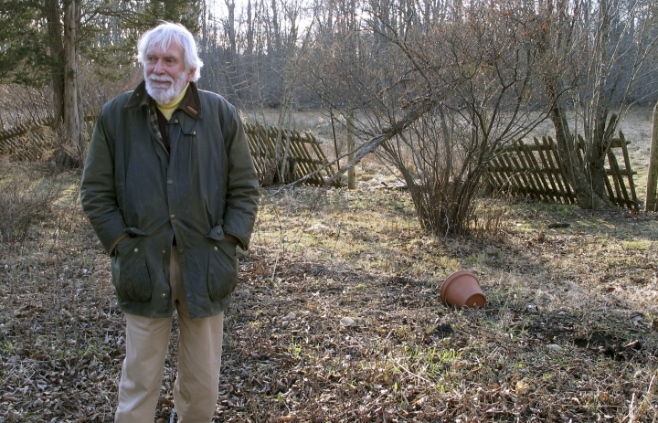 Edward Cook, widower of the late herbalist Adelma Grenier Simmons, poses Thursday, Jan. 3, 2019, in the gardens of the Caprilands herb farm in Coventry, Conn. Simmons, who died in 1997 at age 93, is credited with reintroducing and popularizing the use of herbs in American cooking. Cook, accused of failing to maintain the property, is fighting an eviction order. (AP Photo/Dave Collins)